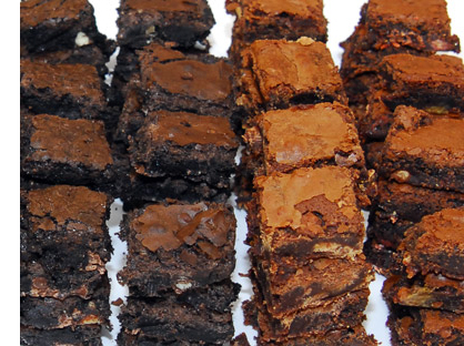 4 rows of ooey and gooey stacked brownies