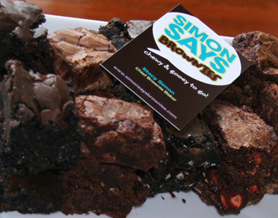 tray of dark and milk chocolate brownies with a business card